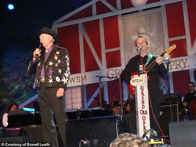 Pennington was a guitarist for 23 years at the famous Grand Ole Opry in Nashville. Pictured: Country musician Jack Greene (left) and Pennington (right) in fall 2009 at the Grand Ole Opry