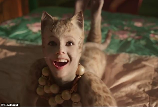 Why the smile: Cats, based on the Andrew Lloyd Webber Broadway musical, is suffering with a terrible 19 percent on Rotten Tomatoes