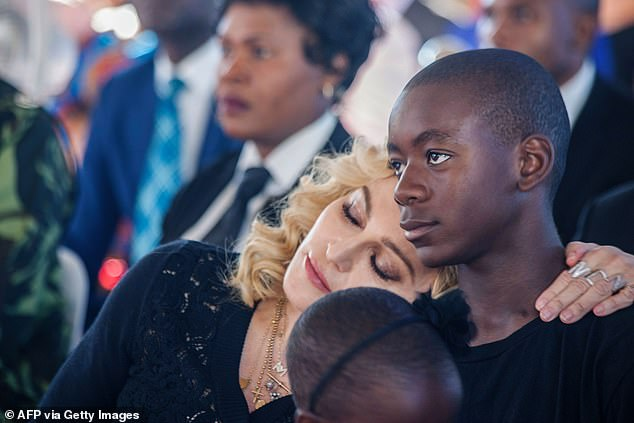 Apart: David Banda, who Madonna adopted during her marriage to Guy, has recently been spending time with Guy in London (the mother and son are pictured in July 2017 in Malawi)