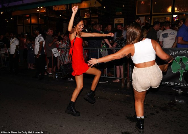 One woman let loose and she danced with her friend on the streets of Sydney