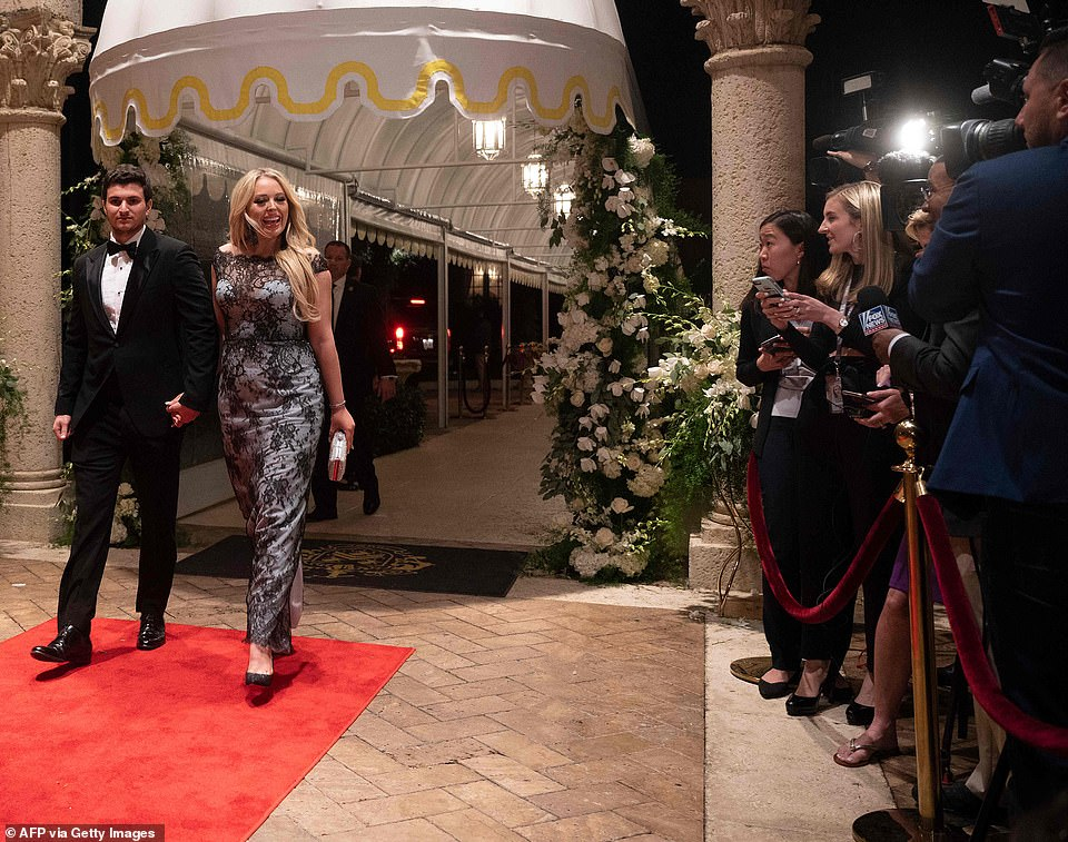 Dapper Barron Trump, 13, attends the Mar-a-Lago New Year's Eve party dressed for nine