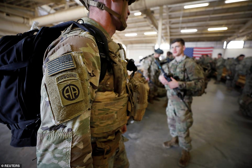 U.S. Army paratroopers of an immediate reaction force from the 2nd Battalion, 504th Parachute Infantry Regiment, 1st Brigade Combat Team, 82nd Airborne Division, prepare to board a C-17 transport aircraft leaving Fort Bragg