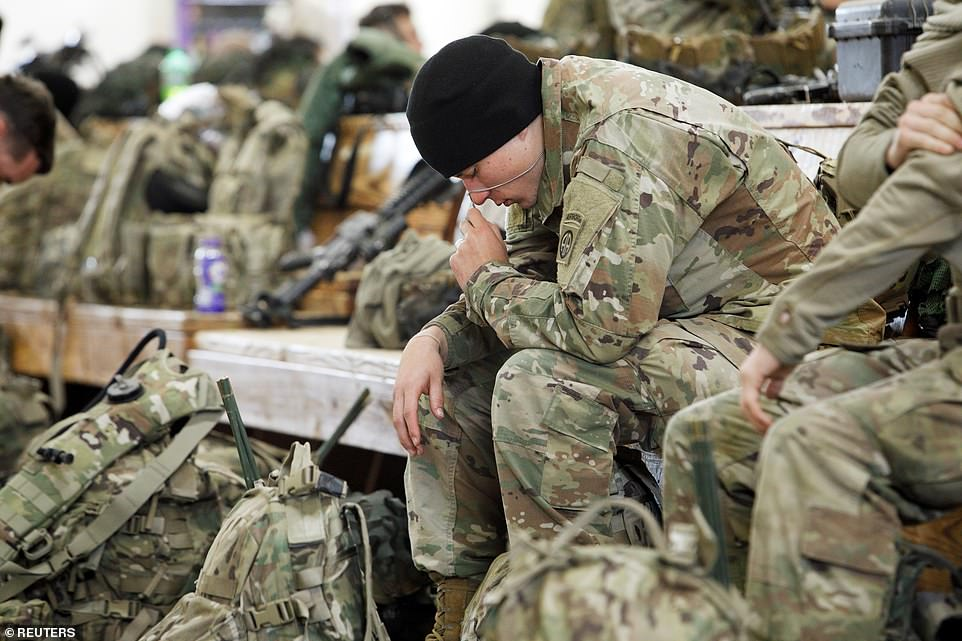 A member of the immediate reaction force reflects before the deployment to Kuwait as US-Iran tensions rise