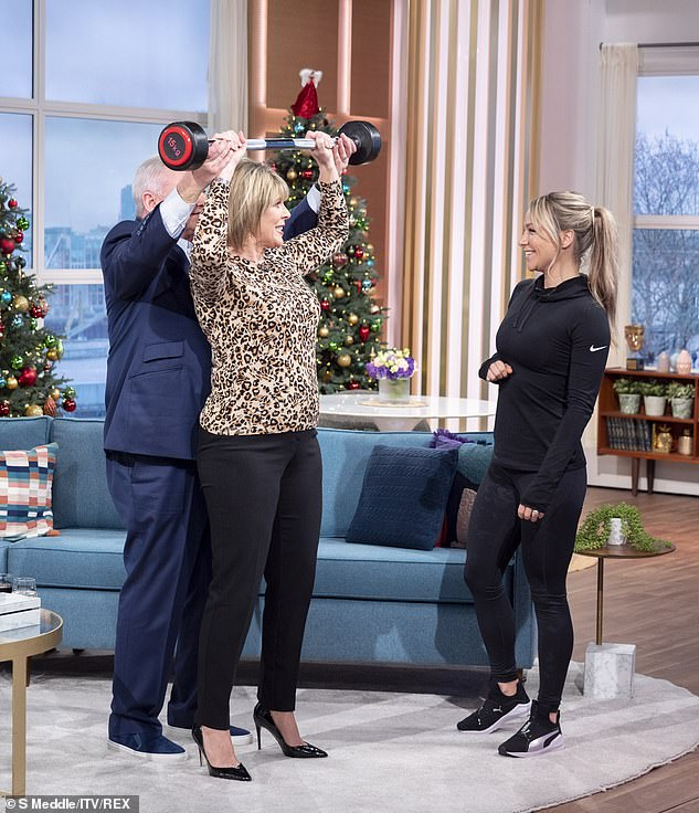 A helping hand:Eamonn came to Ruth's rescue when she could not lift the bar so the duo insisted they would lift together - leading Chloe to encourage a couple's workout