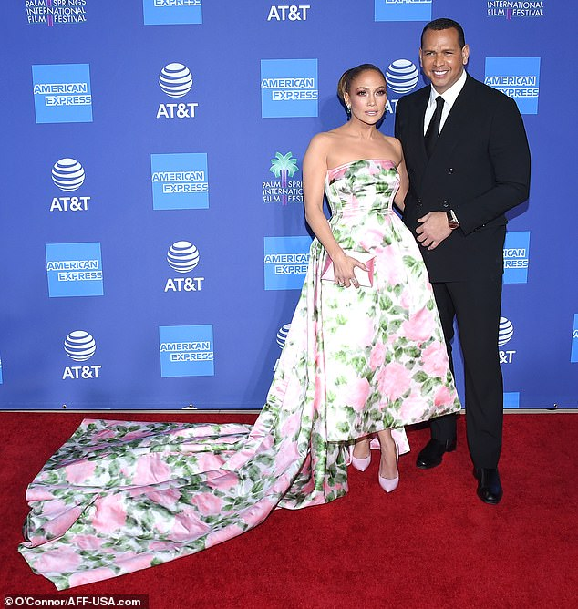 Made an entrance: Jennifer Lopez arrived at the Palm Springs International Film Festival Thursday night in a strapless dress with long train accompanied by fiance Alez Ropdriguez