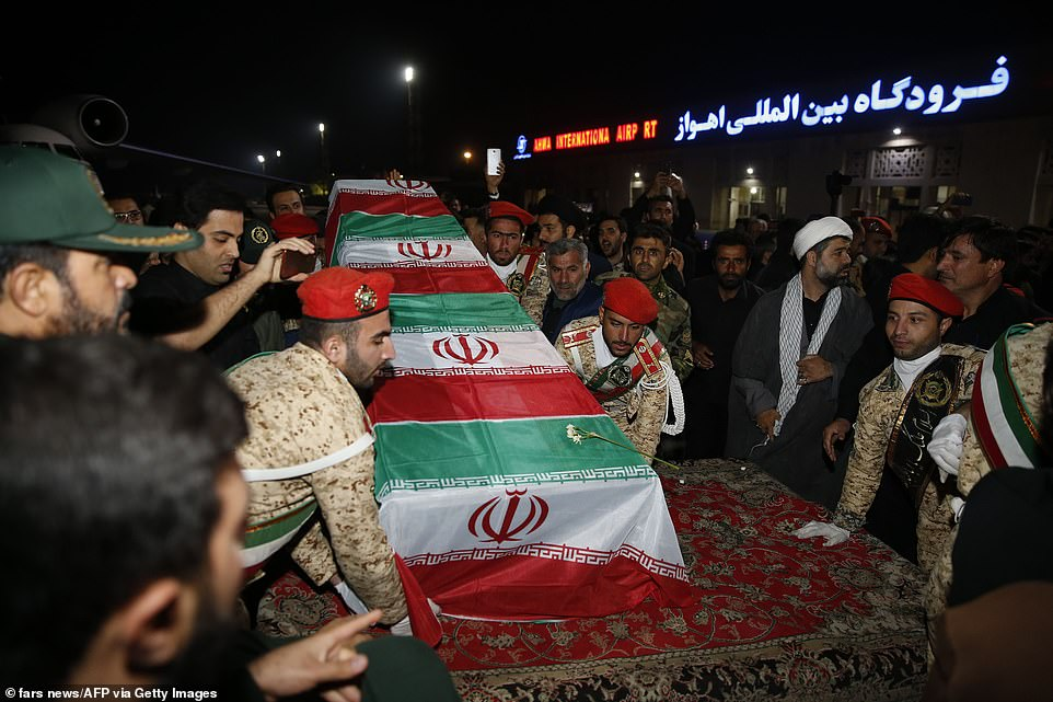 Iranian military members transferred Soleimani's casket at the airport in Tehran after it arrived on Sunday