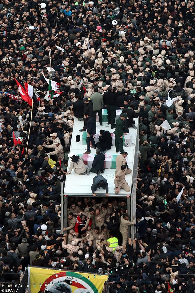 Iranians surround a vehicle carrying the coffin ofQassem Soleimani in the city of Mashhad, in northeastern Iran