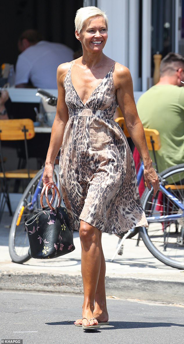 If you've got it, flaunt it! Despite her tangerine hue, the popular TV host looked sensational as she flaunted her slim physique in a plunging leopard print sundress