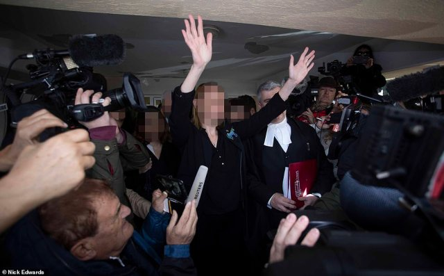The girl's mother held her arms aloft to the throng outsideFamagusta District Court in Paralimni today as she described her daughter's relief but added that she is 'innocent' and declared: 'She's coming home'