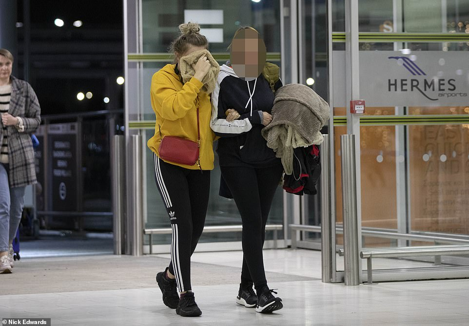 The teenager, from Derbyshire, has been stuck on the island after claiming she was raped by up to 12 Israeli tourists in a hotel room in the party town of Ayia Napa on July 17 (she is pictured preparing to leave Cyprus)