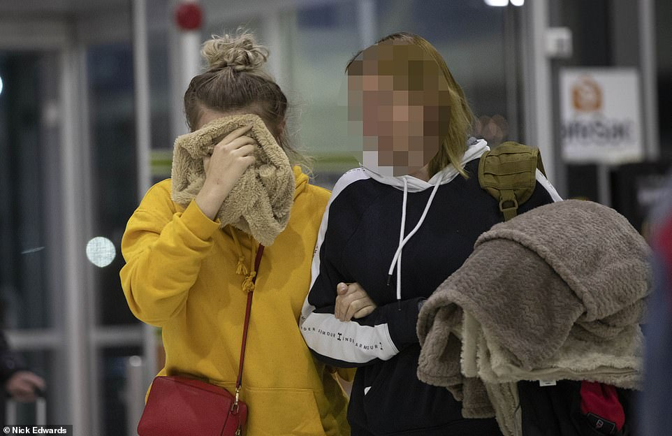 Two passengers on the fully booked 7.30pm flight were offered 500 Euros to give up their seats to allow the mother and daughter to fly home (the teenager is pictured preparing to fly home from Cyprus)