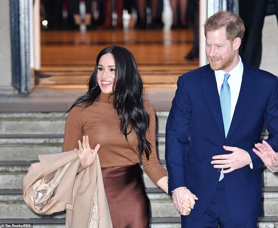 Prince Harry and Meghan put on a public display of affection during their visit to London's Canada House yesterday