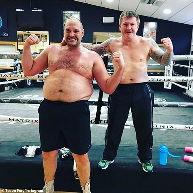 An overweight Fury (left) poses with British boxing legend Ricky Hatton during training