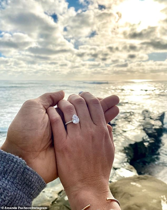 Ocean air: Amanda shared the same image on her Instagram, adding a second photo that showed off her incredible ring close up
