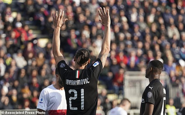 Milan's Zlatan Ibrahimovic celebrates after scoring his side's second goal during an Italian Serie A soccer match between Cagliari and Milan in Cagliari, Saturday, Jan. 11, 2020. (Spada(/LaPresse via AP)