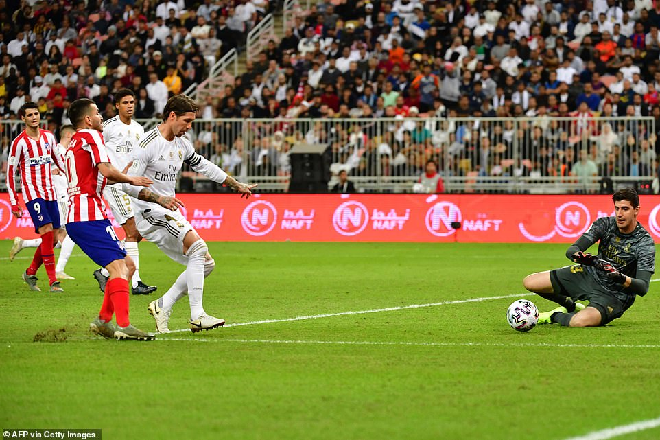 Thibaut Courtois drops to save a shot from Atletico Madrid Angel Correa in the Spanish Super Cup final