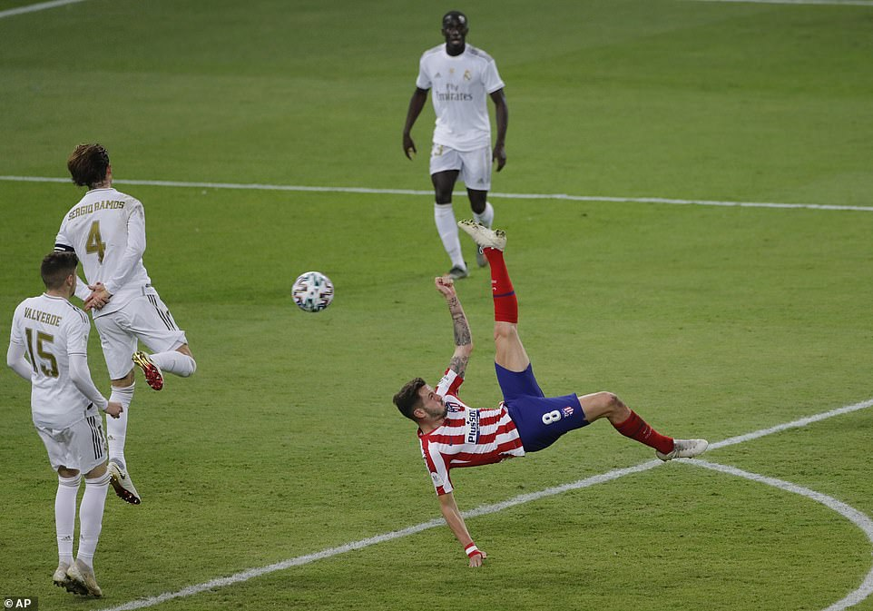 Saul of Atletico Madrid performs an acrobatic bicycle kick against Real Madrid but cannot find the target