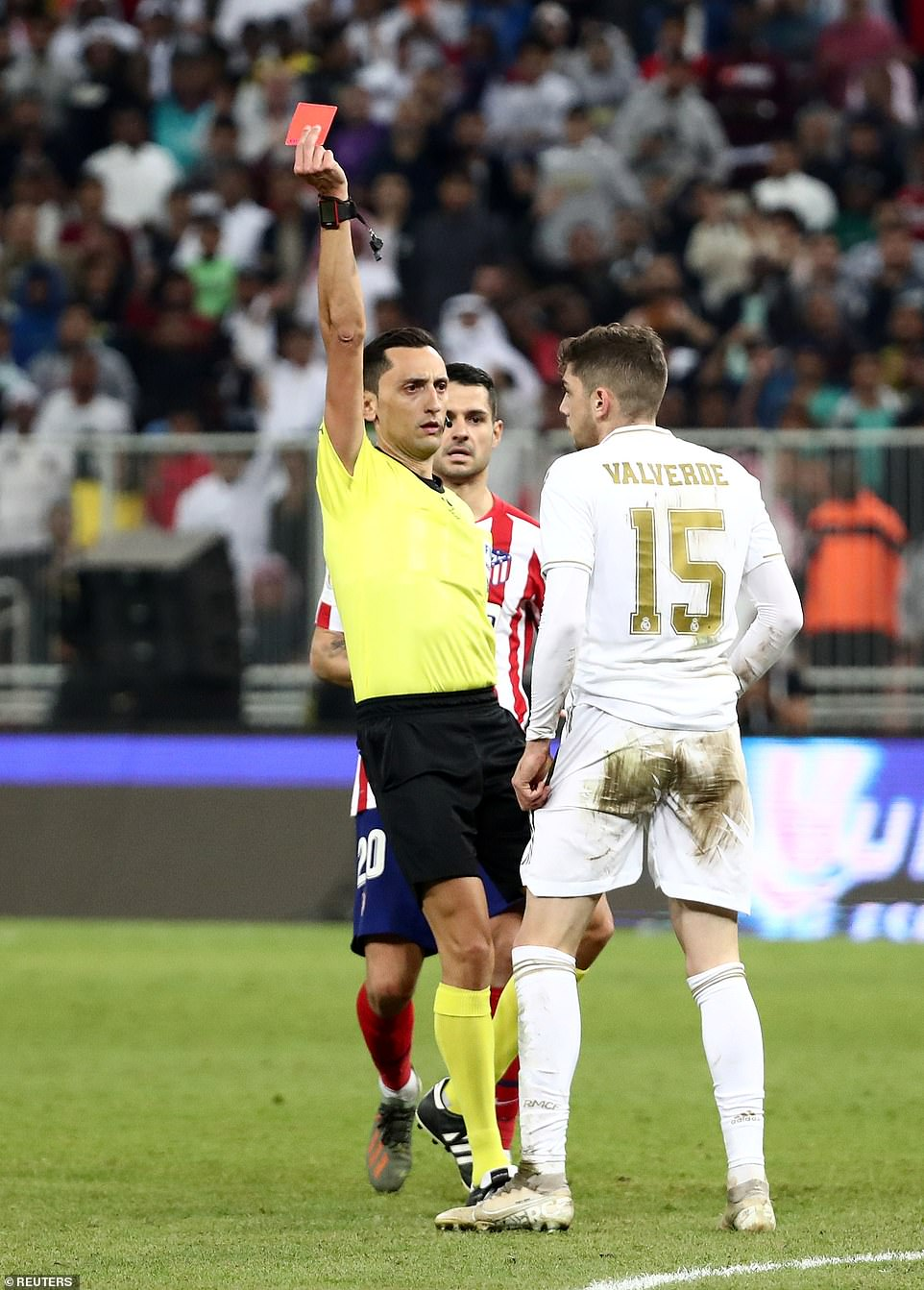 The referee shows a straight red card to Federico Valverde of Real Madrid during the second half of extra time