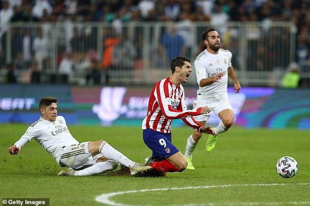 Federico Valverde brought down Alvaro Morata as the Spaniard was put through on goal