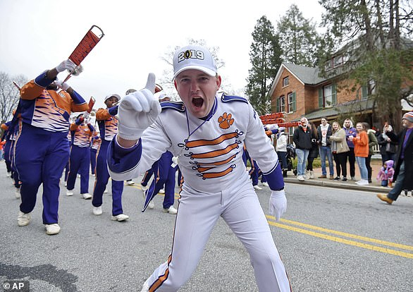 A Clemson band member shows his excitement during a parade honoring Clemson on January 12, 2019, in Clemson, South Carolina, where local officials have lifted open-container laws ahead of Monday's national title game against LSU