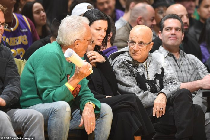 In conversation: Liberty Ross was with her husband Jimmy Iovine, who was spotted deep in conversation