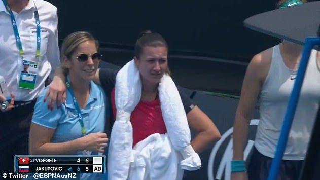 The Slovenian is helped from the court by medical staff and later said she felt 'scared' on court