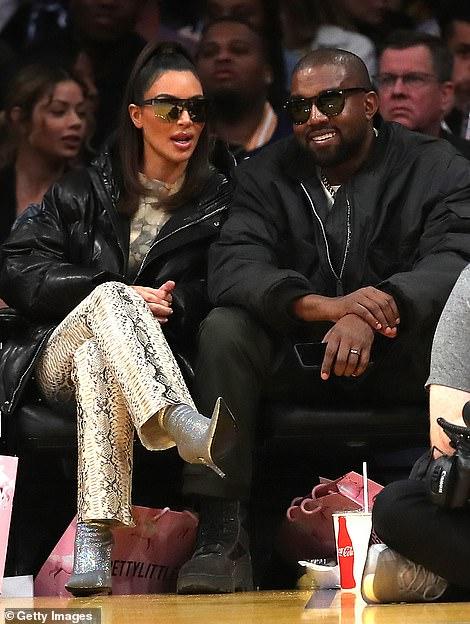 Kanye smile: Kanye showed a rare smiled while Kim talked