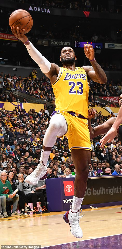 Impressive: James shone once again, pouring in a game-high 31 points and grabbing eight assists – moving him up to eighth in the all-time list – as the Lakers cemented their position on top of the Western Conference table