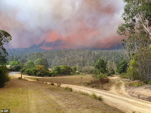 Fire approaches the village of Nerrigundah, Australia in December. The tiny village has been among the hardest hit by Australia's devastating wildfires, about with two thirds of the homes destroyed and a 71-year-old man killed
