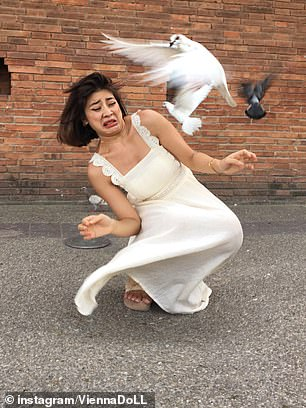 Pictured: A candid snap of the shoot which saw her spooked by the birds