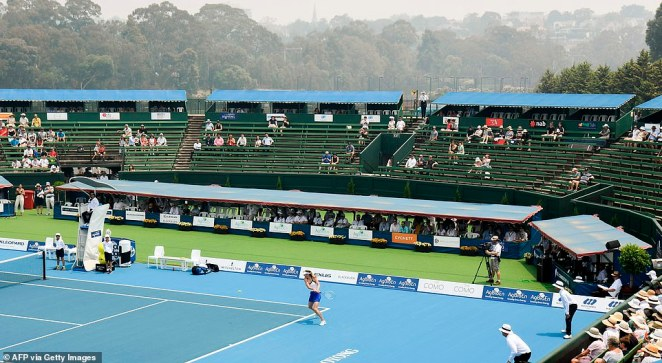 Sharapova's exhibition match in Kooyong was impacted by smoke from the nearby bushfires. The sky can be tinted brown above the court
