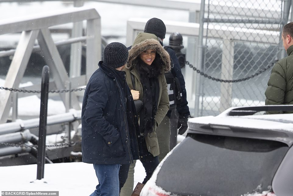 Meghan looked relaxed and happy as she walked to the plane that had other paying customers on board