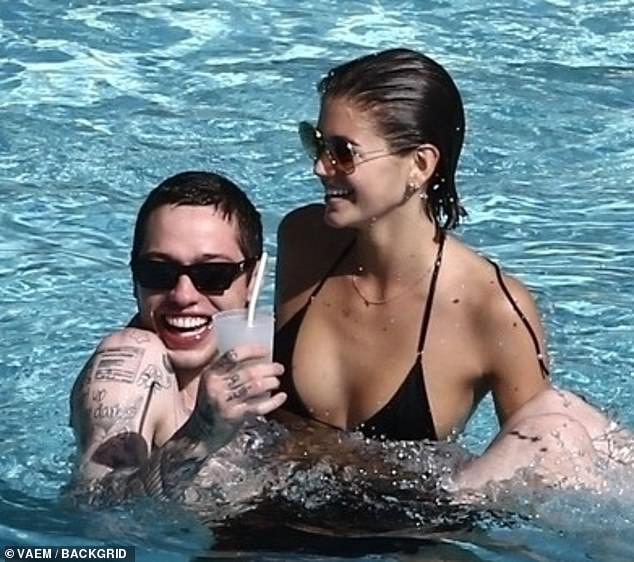 Kaia Gerber and Pete Davidson can't keep their hands off each other as they take a dip in their hotel pool together in Miami Beach in November