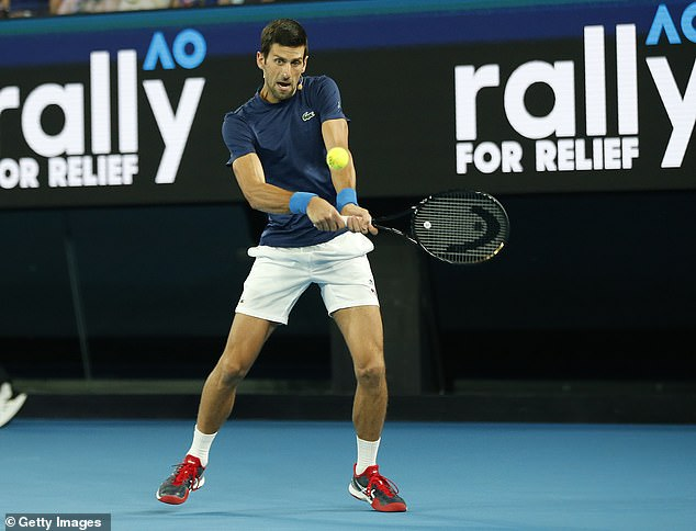 Novak Djokovic, pictured today in Melbourne, has said that the tournament might have to be pulled completely in order to protect players