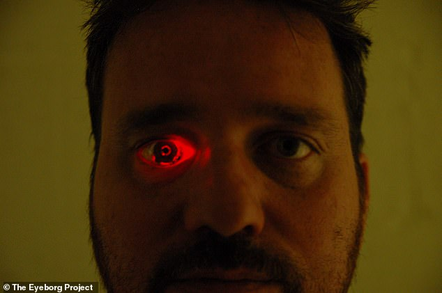 A self-declared 'Eyeborg' filmmaker can record up to 30 minutes of footage with his Terminator-style prosthetic eye that glows red and has an embedded camera