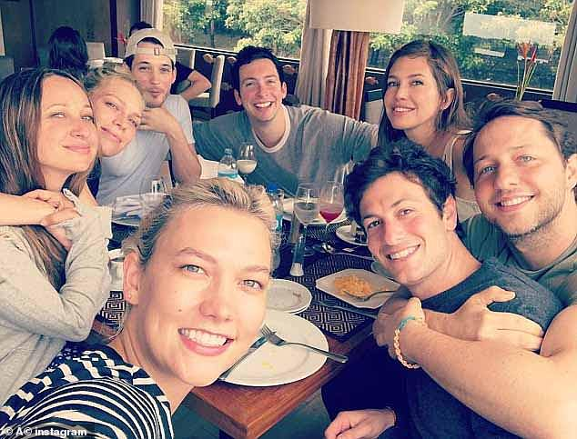 Friends: Karlie Kloss (in front of the image) and her husband Joshua Kushner (on her right), brother-in-law of President Trump's daughter, Ivanka, will also witness how the couple celebrates their marriage.