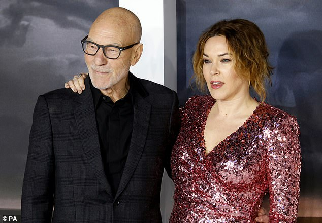 Sweet: Sunny wrapped her arms around Sir Patrick's shoulder as they posed for photos.