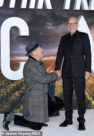 Could you? Sir Ian looked up and laughed as he held Sir Patrick's hand while he was on one knee, and pretended to propose