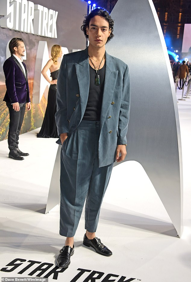 Smart casual: Evan Evagora, who plays Elnor, put on a blue suit and a black blouse.