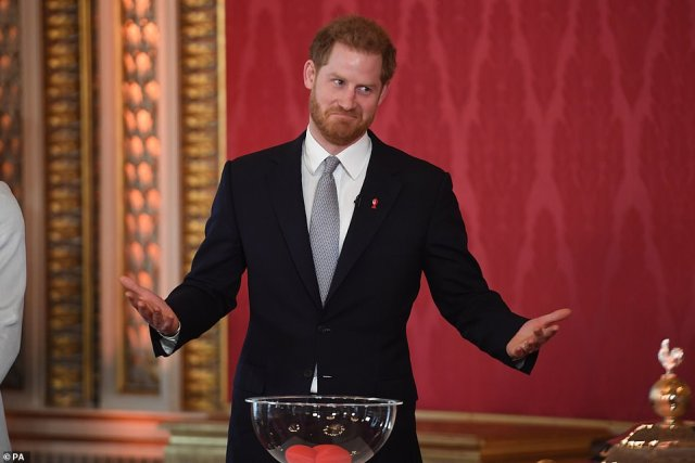 Harry managed to crack a wry smile after mixing the balls as hehosted the Rugby League World Cup 2021 draws at Buckingham Palace in what could be his final full royal engagement in his current role