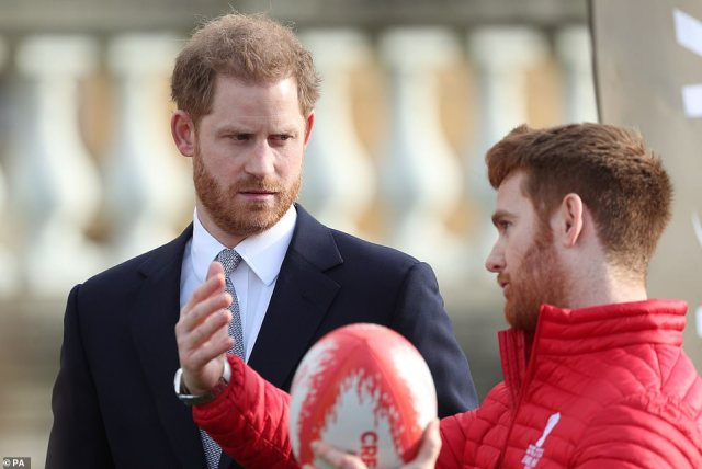 The Duke of Sussex talks with Leeds Rhinos player James Simpson at Buckingham Palace today