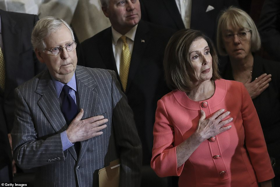 Pelosi (right) was seated with rival Senate Majority Leader Mitch McConnell (left) at the Congressional Gold Medal ceremony on the Capitol an hour before the Engrossment Ceremony