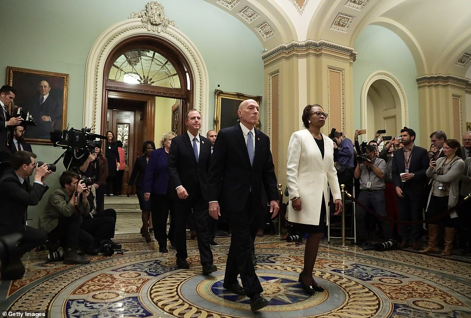House Clerk Cheryl Johnson, House Sergeant at Arms Paul Irving and the impeachment managers leave the Senate after depositing the impeachment articles