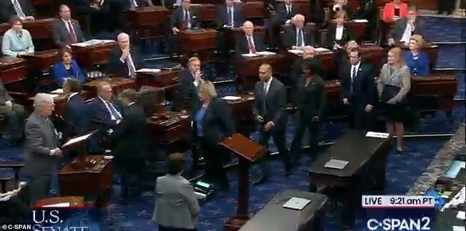 Filing out: It took just 15 minutes for the trial to formally begin, with the Democratic senators leaving so the Senate could move on to the next order of business, dispatching senators to the Supreme Court to summon the Chief Justice