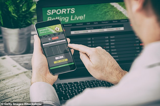 Gambling addiction costs the NHS up to £700million a year. Stock picture