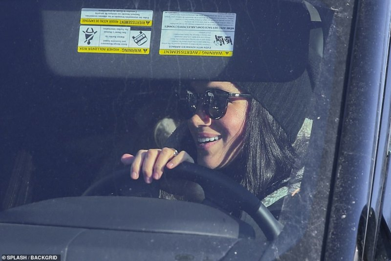 A smile spread across Meghan's face when she spotted her friend approaching the car