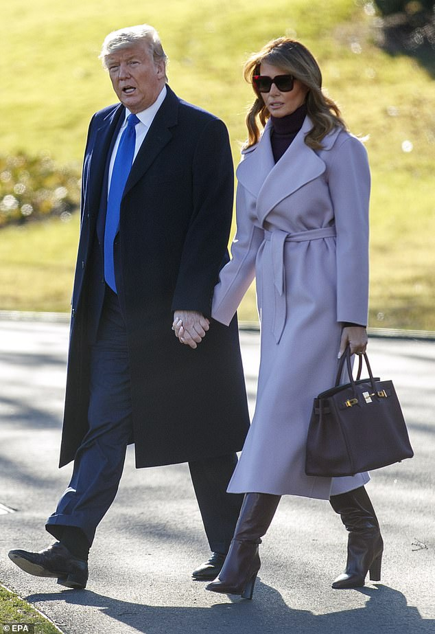 Travel outfit:Melania looked ready for spring in a $1,570 pink camel hair coat from Max Mara, which she paired with burgundy leather boots and a matching Hermes Birkin bag
