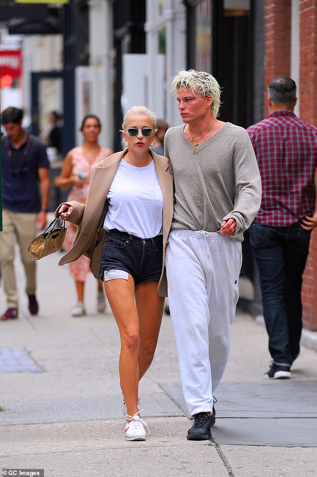 Making headlines: The photogenic personality has made headlines in recent months for his rumoured romance with Caroline Vreeland, 32 (pictured together in New York in September)