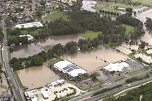 A torrential rain bomb hammered down on Queensland and NSW on Saturday, with the Gold Coast the worst affected (pictured)