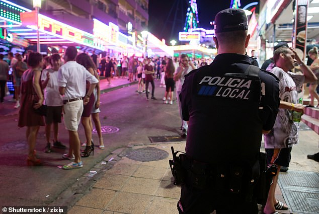 In one incident on the strip a British holidaymaker was filmed performing sex acts on 24 men. (A Spanish policeman on the Magaluf strip in 2018)